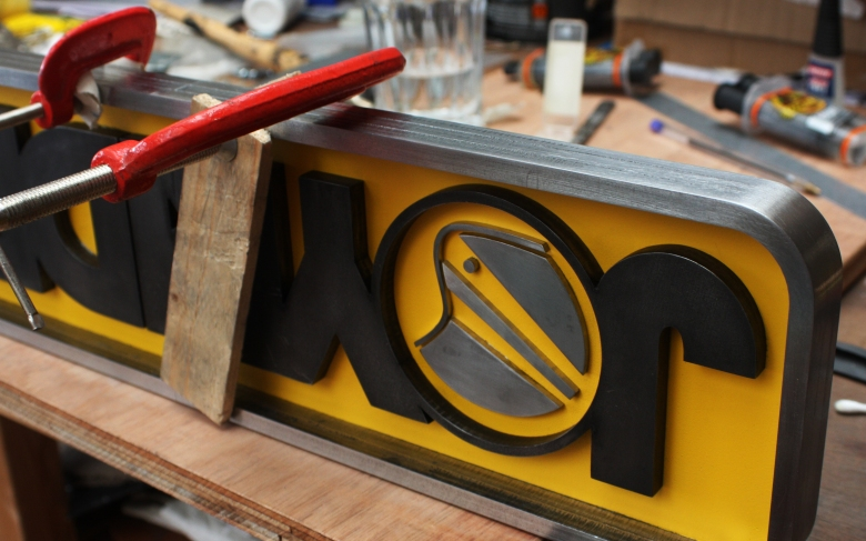 Setting the glue within the Joyrider sign by Type Design