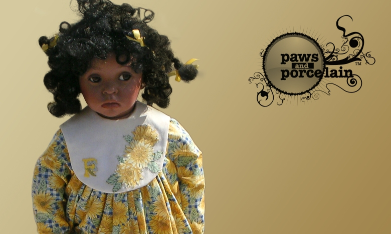 Paws and porcelain website graphic by type design, showing porcelain doll with logo